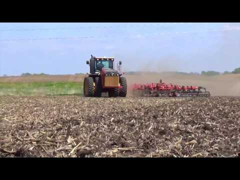 New Versatile 375 Tractor pulling a Kuhn Krause Field Cultivator