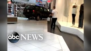 A driver crashed an SUV through a Chicago-area mall