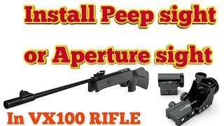 Install Peep sight or Aperture  sight.