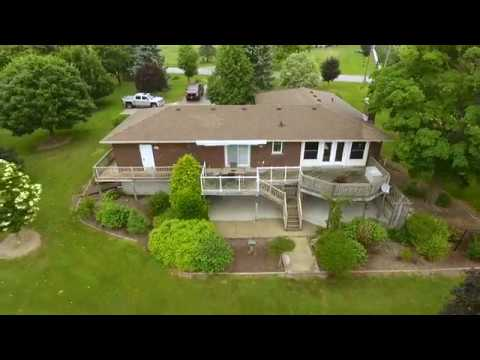 Open Concept Bungalow with Beautiful Green Space on 1.4 acres