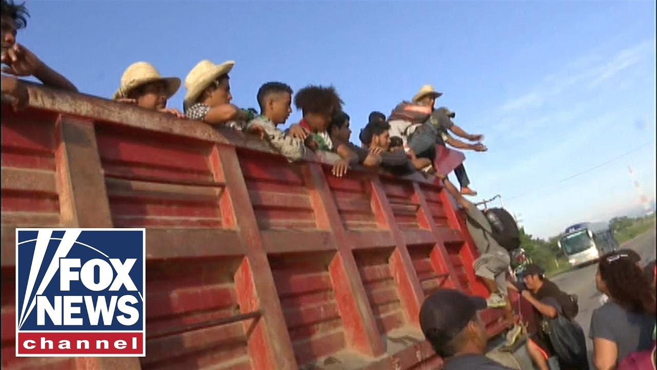 migrants-board-trucks-en-route-to-mexico-city