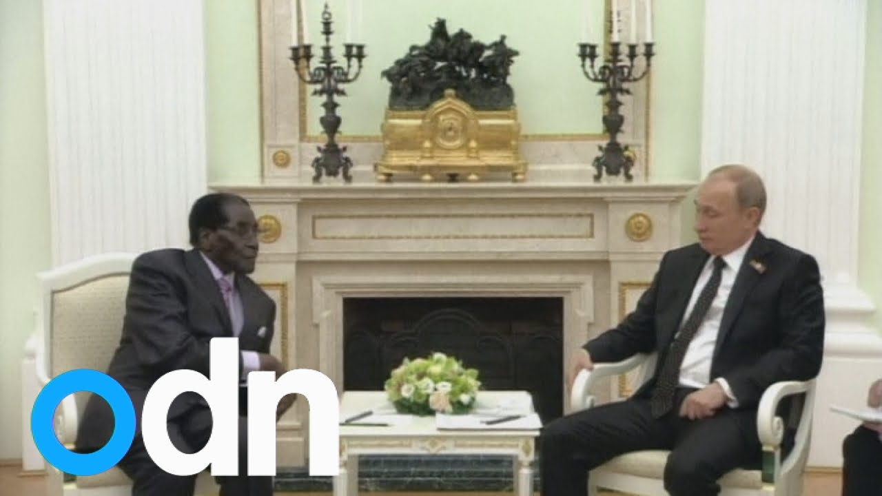 Putin and Mugabe make jokes about sanctions at a meeting in Russia