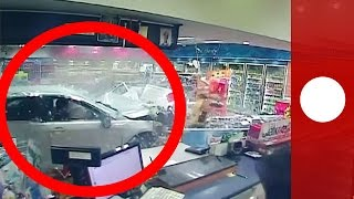 CCTV: Car smashes into gas station, narrowly missing woman