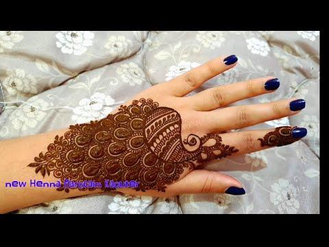 رسم او نقش طائر الطاووس بالحناء شاهدو النهاية Drawing or engraving of a peacock bird with henna - New Henna Marocain kaouter