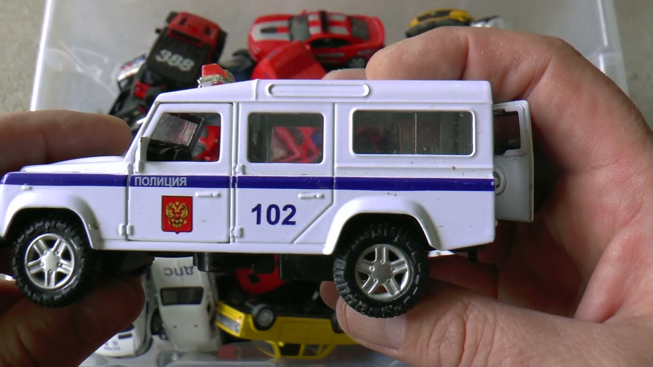 Cars being reviewing from the box full of toy diecast model cars