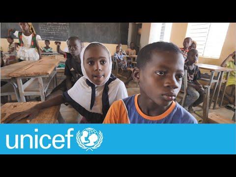 Children learning through a radio in Burkina Faso | UNICEF