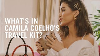 Camila Coelho shows her flight kit to Rosie Huntington-Whiteley