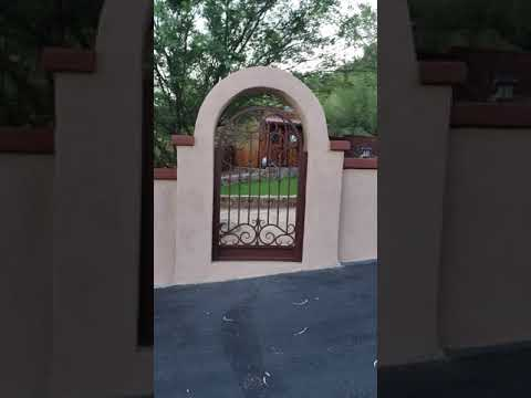 2 wrought iron gates installed in a courtyard - by Affordable Fence and Gates, Tucson AZ