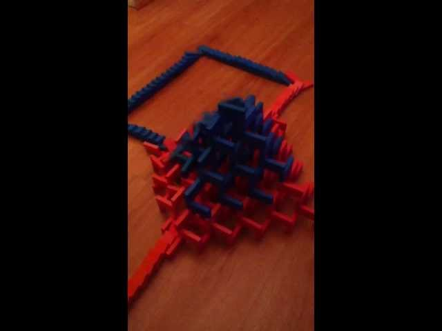 Domino line through  domino pyramid. Travel Video