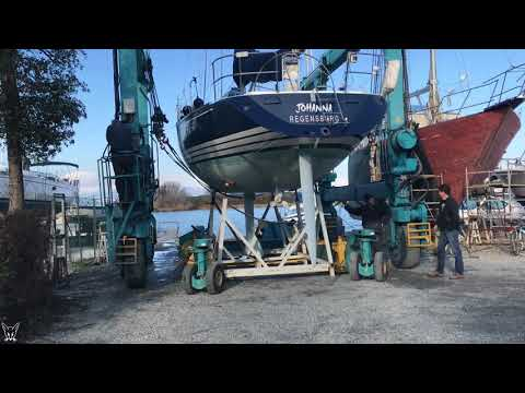 Our sailboat in the crane: From water to land. How to move 8 tons.