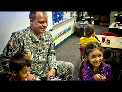 Soldier surprises daughter with homecoming in Belding elementary classroom