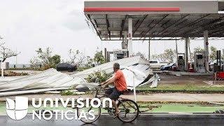El día después del paso de María los puertorriqueños encuentran una isla rota