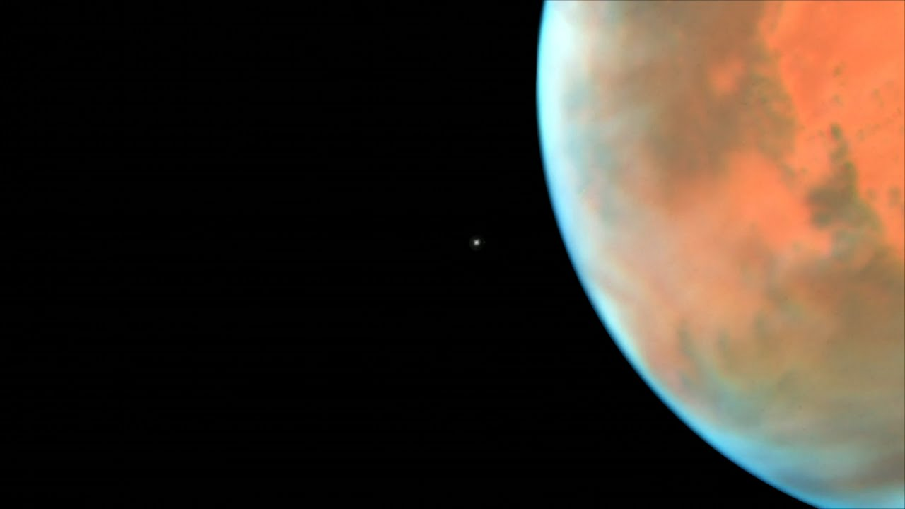Hubble sees martian moon orbiting the Red Planet