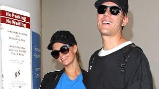 Paris Hilton And Chris Zylka Entertain Fans At LAX