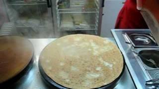 Теремок making blueberry-filled blini (pancakes)