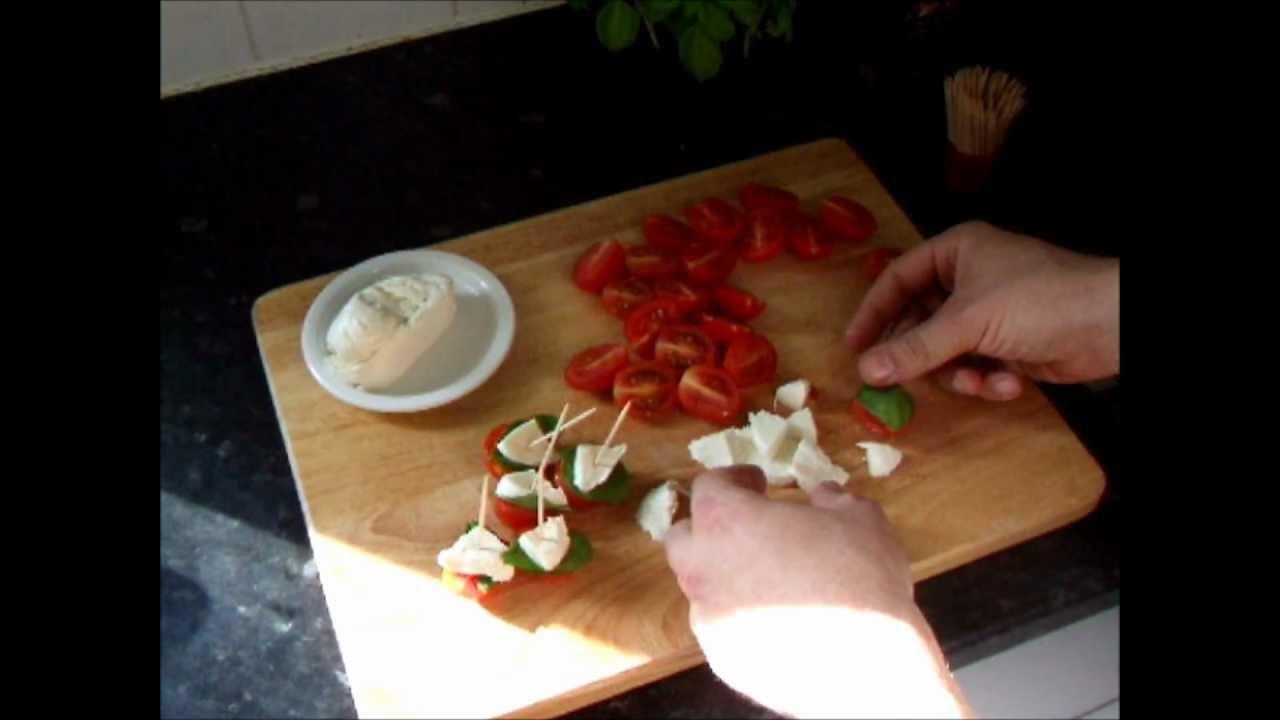 Insalata caprese canapes tomato mozzarella basil hors d for Mozzarella canape