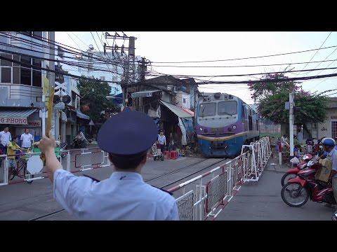 Train SE8 Saigon - Hanoi passing in Ho Chi Minh City (2015)