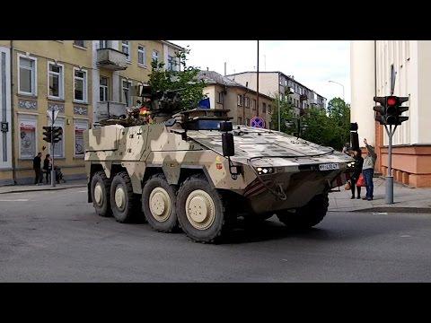 NATO military vehicles leaving Šiauliai city centre