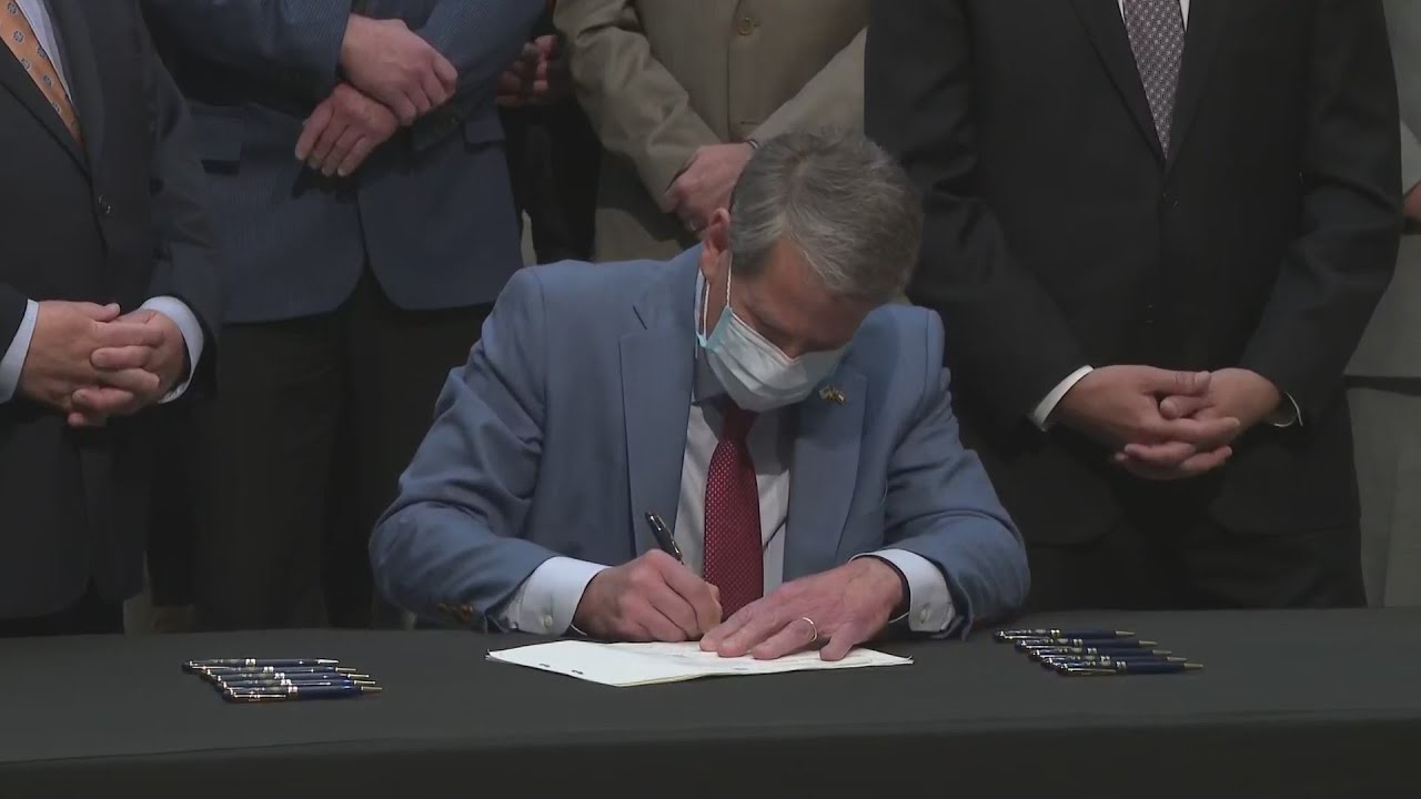 Gov. Kemp signs bills to cut taxes for Georgians and increase incentives for adoption