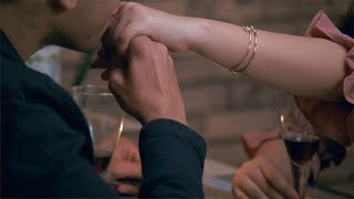 Indian teenage couple enjoying a candlelight dinner date in a luxury lounge - Love and Relationship