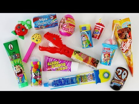 Mixing crazy candy, slime candy, weird candy dispensers, super sour warheads, lollipops