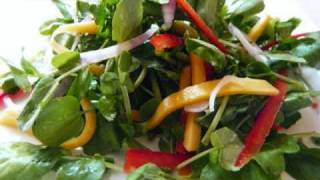 Caribbean Watercress Salad Topped With Julienne Mango.