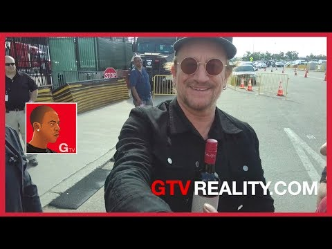 U2 hangs out with fans outside concert venue on GTV Reality Bono and The Edge