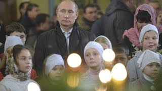 Putin attends Russian Orthodox Christmas Eve Mass