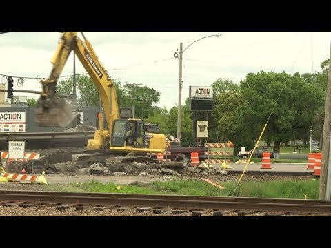Driver hits county road construction worker