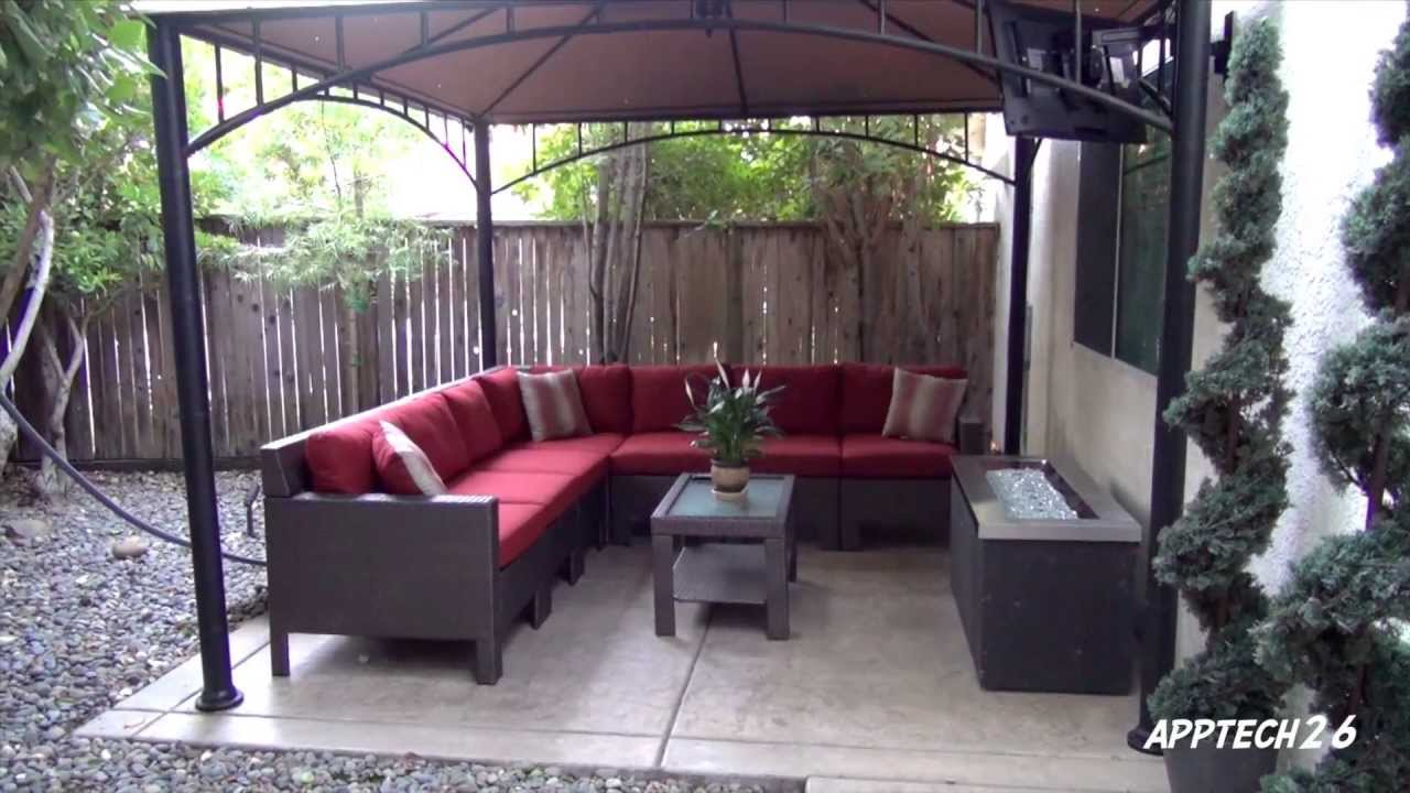 backyard before & after remodel- tv, fire pit, l-shaped couch