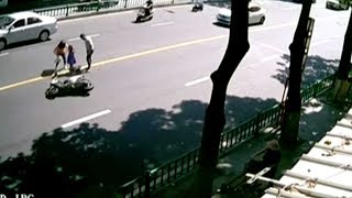 Motorcycle performs 360 degree flip in a road accident in China