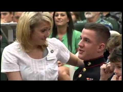 Marine surprises sister during graduation.