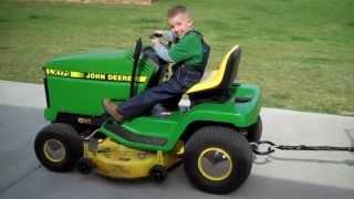 Hayden driving his tractor.