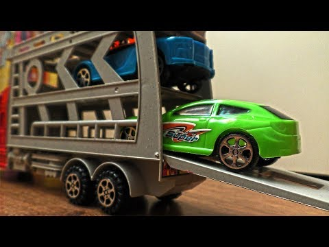Video About Plastic Toy Cars Being Carried By Transportation Vehicles