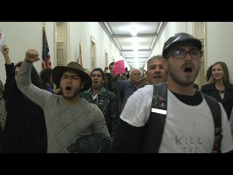 Hundreds of protesters fight the GOP tax bill at the Capitol
