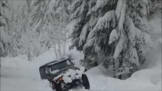Jeep Wrangler in Deep Snow Pacific Northwest Cascades of Oregon