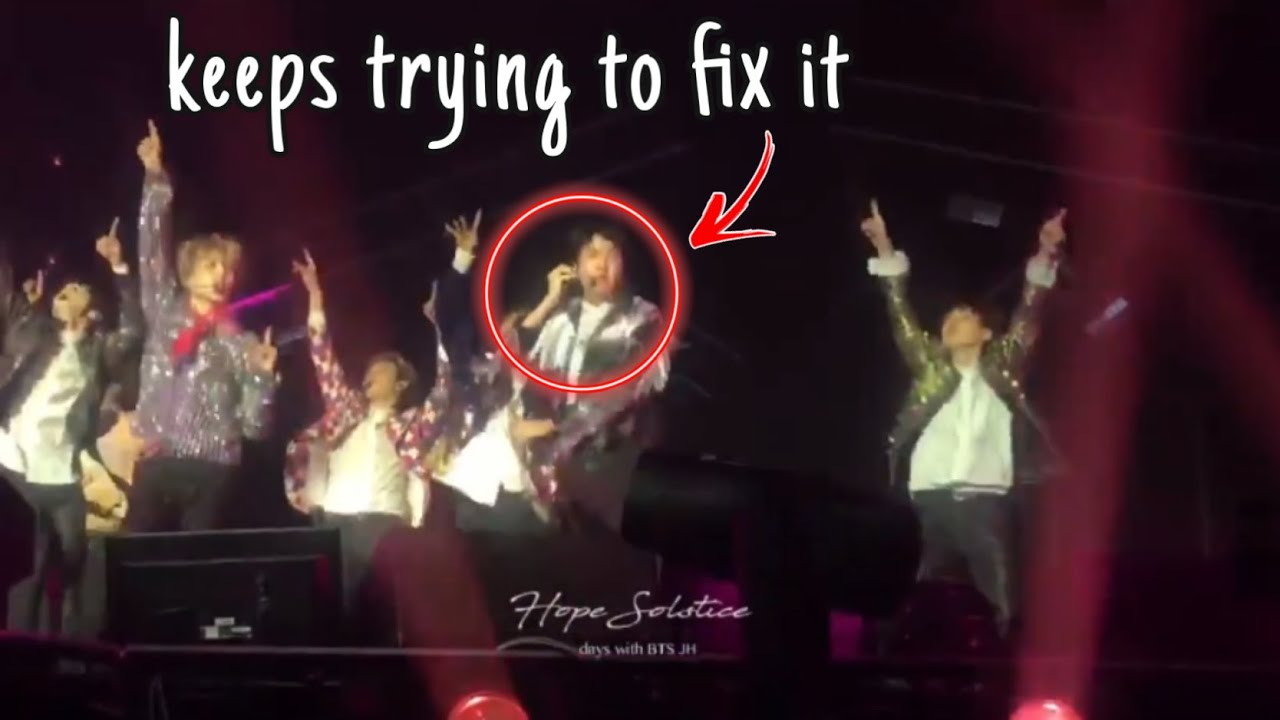 Hoseok tries to inform the staff of his mic issue while performing