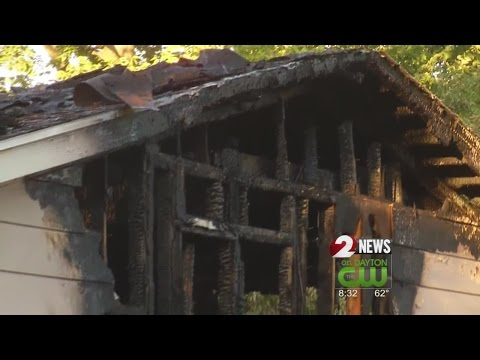 Woman transported after house fire