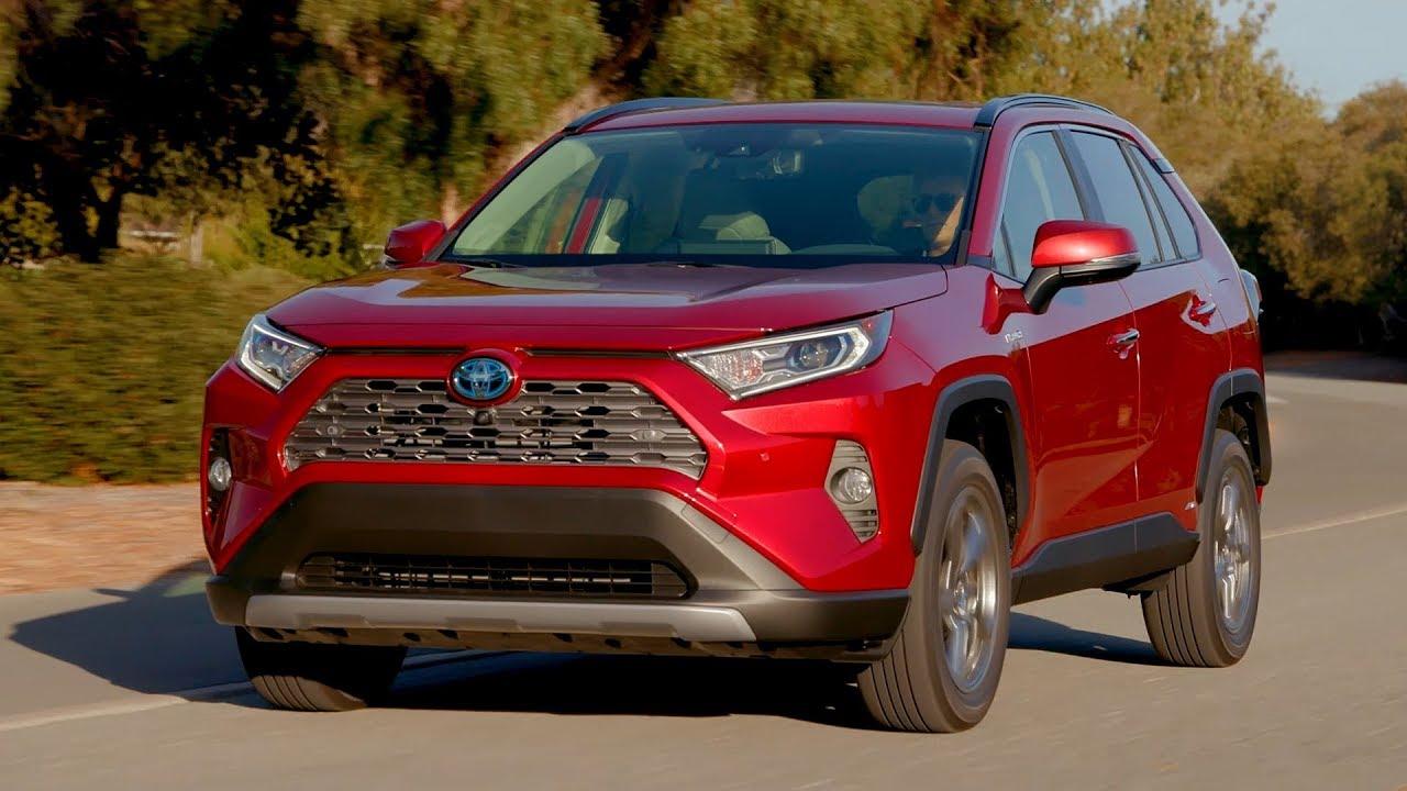 2019 Toyota Rav4 Limited Hybrid Ruby Flare Pearl Driving