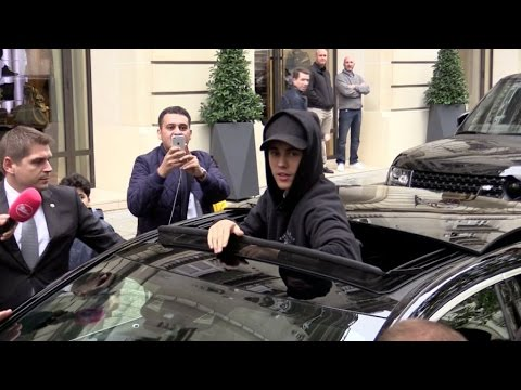 Justin Bieber coming out of his hotel in Paris