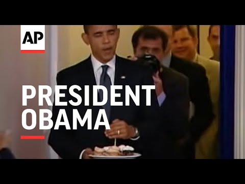 President Obama made a surprise visit to the White House press room on his birthday to deliver cupca