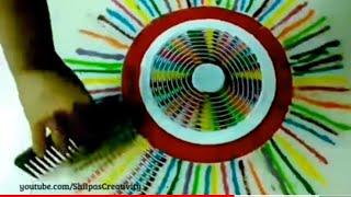 Holi Rangoli design: Rangoli using comb with multicolors  by creative hands