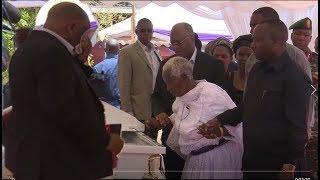 MACHOZI: Rais Magufuli akimuongoza Mama yake kuaga Mwili wa Monica