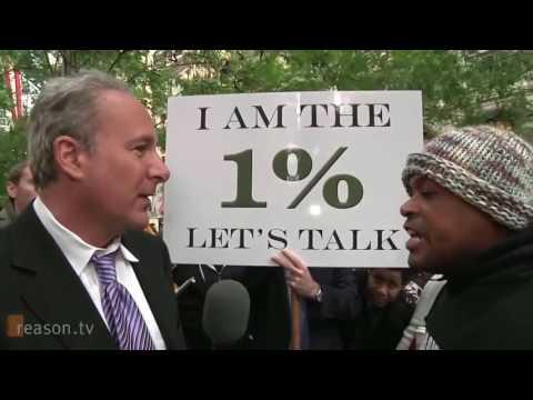Socialist Protester Debates Wealthy Businessman Peter Schiff