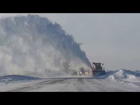 Industrial snow blower clearing Illinois Roads.