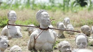Ghana's sea of sculpted slave heads commemorate slave trade, 400 years on