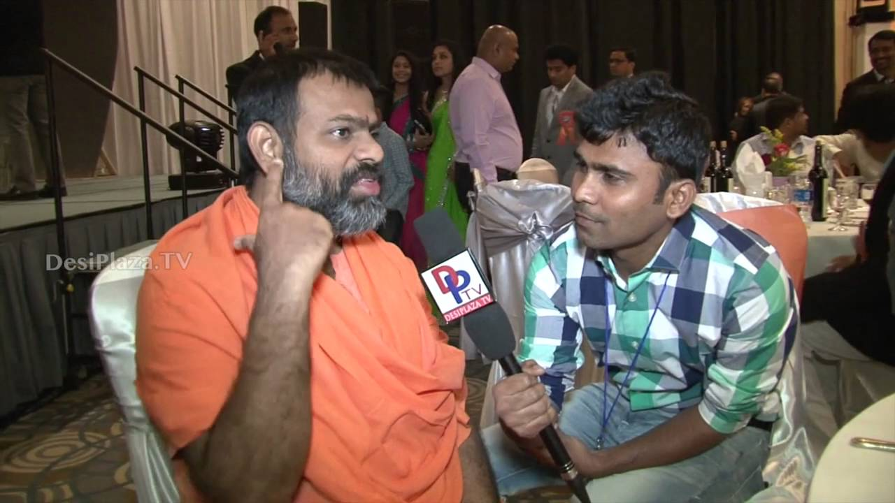 Paripoornanada Swami speaking to Desiplazatv American Telangana Association