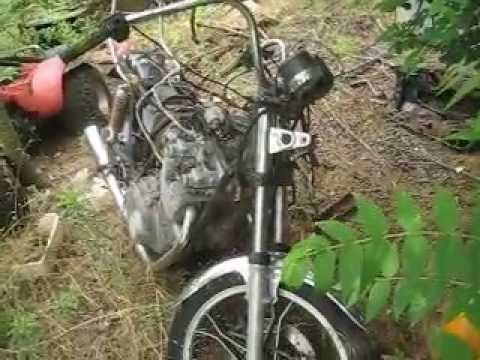 Abandoned junk yard walking threw a only motorcycle for Motor cycle junk yard