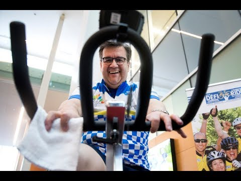 Denis Coderre rides a bike for World Cancer Day
