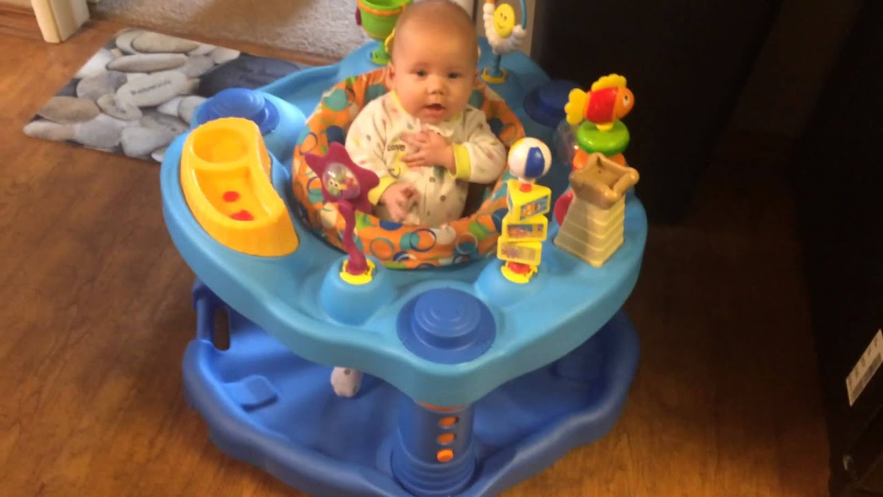 Baby Elliana plays in the exersaucer 4 1 2 months old